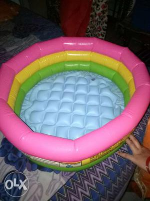 Round Gray, Pink, Yellow, And Green Inflatable Pool