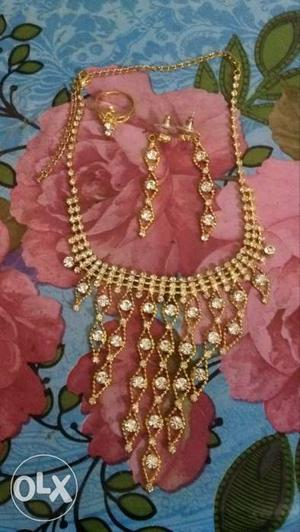 Artificial Gold and Diamond Long Necklace And Earrings(new)