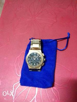 Round Black Chronograph Watch With Gold Link Band With Pouch