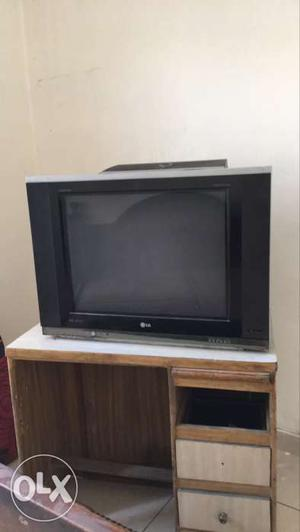 Black LG Widescreen CRT TV On Brown And White Wooden Single