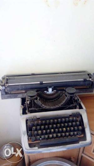 Grey And Black Typewriter Machine