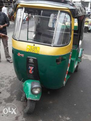 Green And Yellow Electric Rickshaw