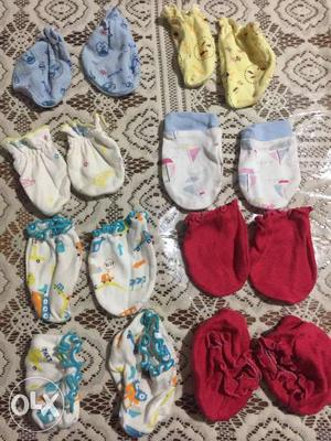6 pairs of mittens and baby shoes for new born.