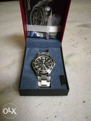 Round Black Casio Chronograph Watch With Silver Link Band