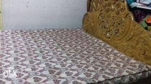 Brown Wooden Bed With Brown And White Bed Mattress