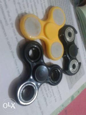 Three Black And Yellow Fidget Hand Spinners