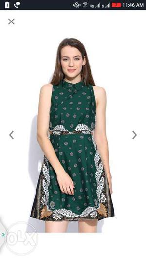 Women's Green, White, And Black Sleeveless Dress Screenshot