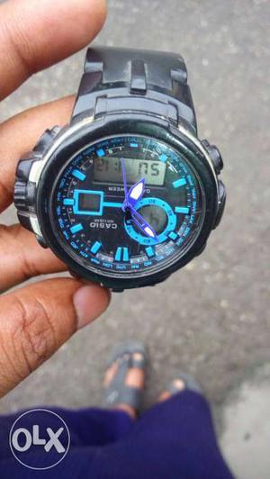Round Black And Teal Casio Digital Watch