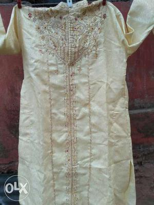 Brand new Men's light cream color cotton silk Sherwani Set.