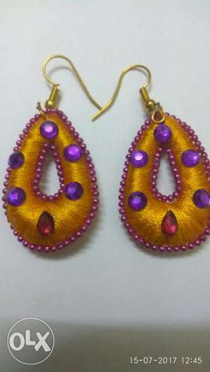 Hanging earings made with yellow silk thread and