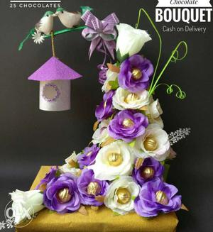 White And Purple Petaled Flowers With Chocolate Party Favors