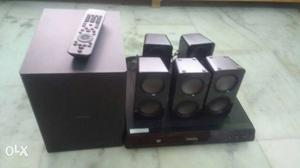 Unused Philips home theatre with 5 speakers and