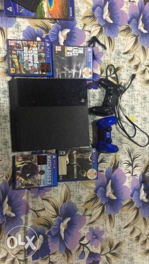 PLAYSTATION 4 with 5 games and an extra controller
