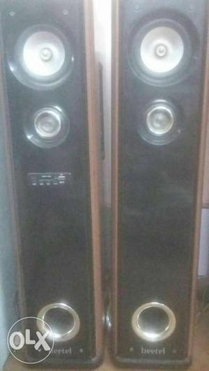 Two Black Tower Speakers with wireless mic