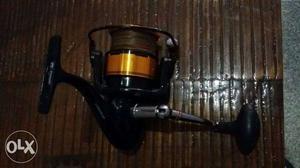Yellow And Black Fishing Reel