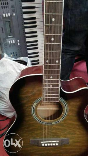 Acoustic guitar, in good condition, is been used for 5