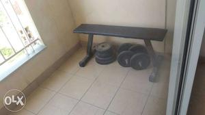 Zym bench and rubber weights and dumbell bars.