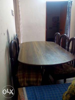 Sheesham Brown Wooden Oval Table With Six Wooden Chairs