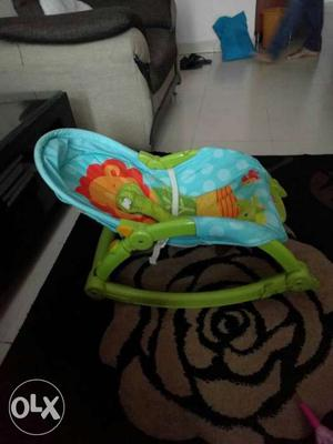 A 4 months old fisher price rocker in fantastic