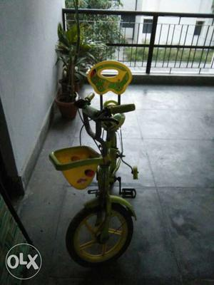 Green And Yellow Bike With Training Wheels