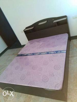 Queen size double bed with mattress. Bed is in