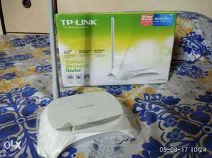 2.5 months old, White TP-Link 150 Mbps Wireless N Router