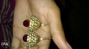 Pair Of Gold-and-maroon Embellished With Diamonds Jhumkas