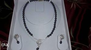 Pure pearls with american diamond.brand-Chandrani