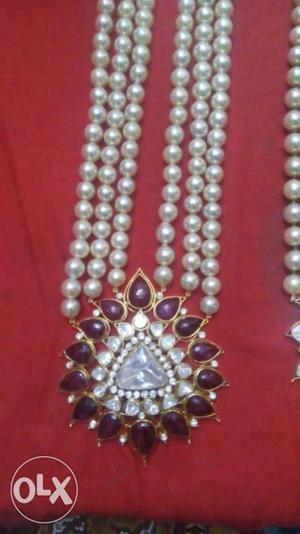 22 carat Hallmark gold and diamond Pendant and pearl