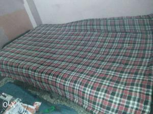 A 6*4 single cot with mattress is up for sale.