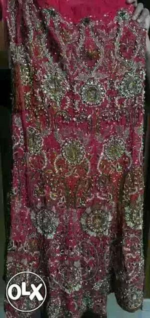 A beautiful red colour bridal party wear lehnga,