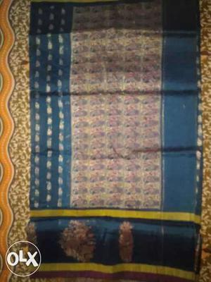 It's pure silk rama and rani colour sari