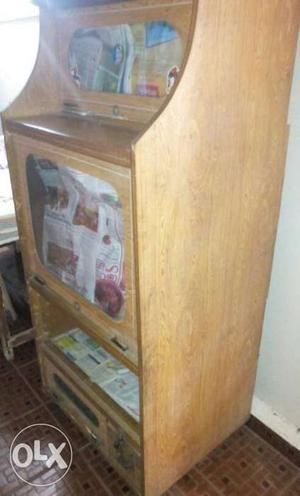 Old Tv Stand Attached With Four Shelf In Good