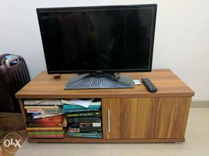 TV unit in wood finish for sale. Can be doubled
