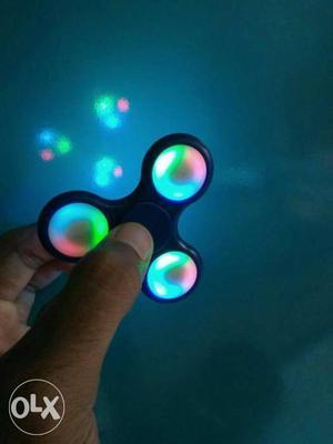 L E D multi color light changer fidget spinner