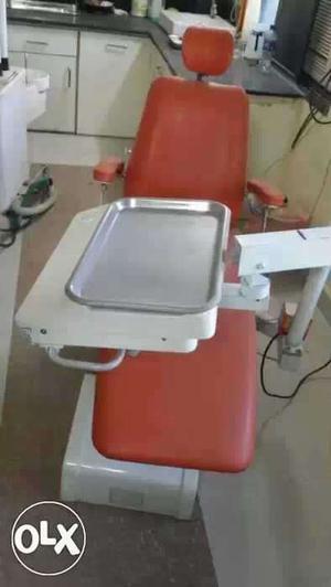 Orange coloured hydraulic Dental Chair
