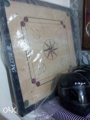 1 month old 'new' carrom board! bought for 800.