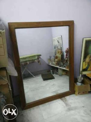 A big mirror use in home or beauty parlour teak