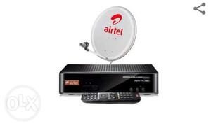 Black Airtel Player, Remote Controller, And Satellite