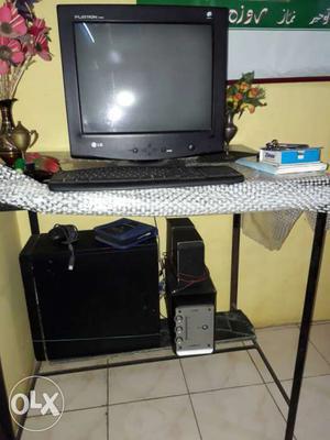 Black LG Monitor; Black Computer Tower; Black Corded