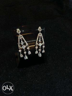 K&A Jewels Fashionable Rhodium Plated Diamond look Earring.