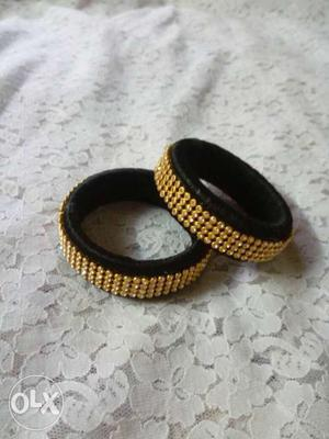 Two Gold And Black Beaded Band Rings