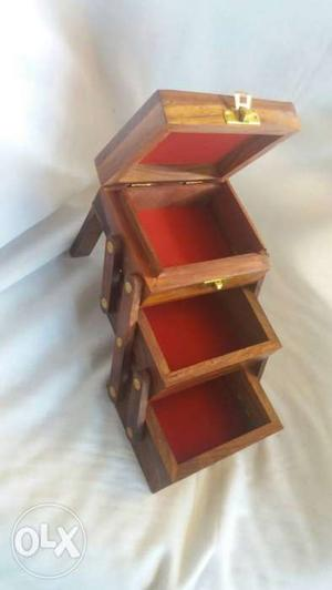 Wooden hand carved expandable jewellery box. Made