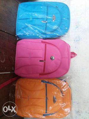 Three Blue, Pink, And Orange HP Laptop Backpacks