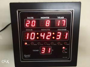 Ajanta Quartz Digital Clock with date, day,