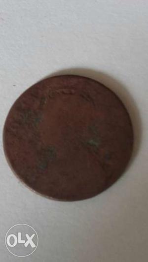 One Quarter Anna  coin and 25 paisa coins