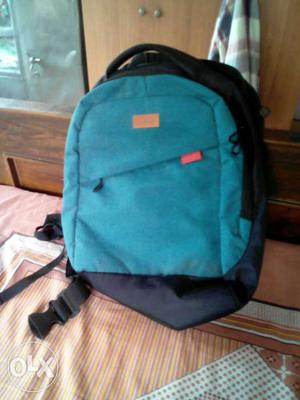 Black And Teal Backpack