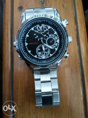 Round Silver Chronograph Watch With Silver Link Band.