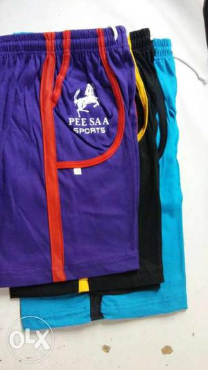 Thee Purple, Black, And Teal Sport Shorts