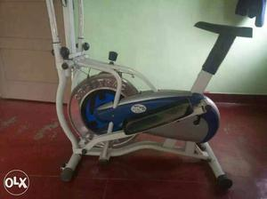 Silver And Blue Elliptical Trainer